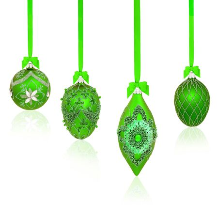 Luxury green Christmas tree bauble decorations with bows and ribbons on white Фото со стока