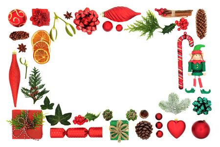 Festive Christmas background border with tree bauble decorations, food items, symbols and winter flora on white background with copy space.