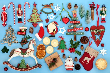 Symbols of Christmas with retro tree decorations, food and winter flora and fauna on pastel blue background.