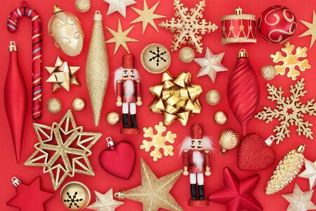 Christmas tree bauble decorations and symbols on red background. Traditional greetings card for the festive season.