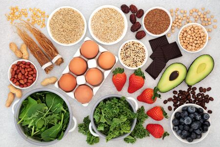 Health food for vitality, energy & fitness with vegetables, nuts, seeds, legumes, grains, cereal, dairy & herbal medicine. Foods high in vitamins, minerals, antioxidants, smart carbs, protein & omega 3. Flat lay.