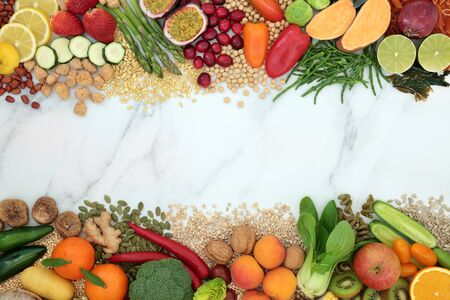 Vegan health food background border with a large collection of foods. High in protein, vitamins, minerals, antioxidants, fibre, anthocyanins, omega 3 and smart carbs. Ethical eating food concept. Flat lay.