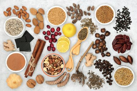 Herbal medicine and a variety of health foods for a healthy heart and cardiovascular system on marble background. Flat lay.