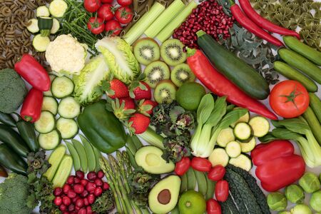 Vegan health food collection with plant based green and red foods of fruit & vegetables and pasta. High in vitamins, minerals, antioxidants, anthocyanins, fibre and smart carbs. Flat lay. Stok Fotoğraf