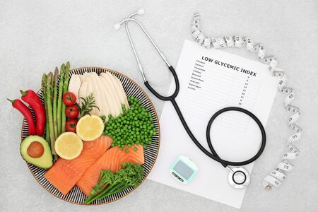 Low glycemic health food for diabetics with list, stethoscope, pedometer, tape measure & foods high in vitamins, minerals,  antioxidants, protein & omega 3. Below 55 on the GI index. Flat lay. Stock Photo