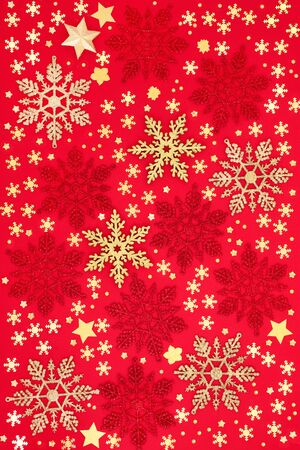 Christmas snowflake and star bauble decorations on red background. Traditional greetings card or wrapping paper design for the festive season.