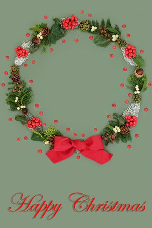 Happy Christmas wreath with a variety of flora and fauna and loose holly berries with red bow on green background and title.