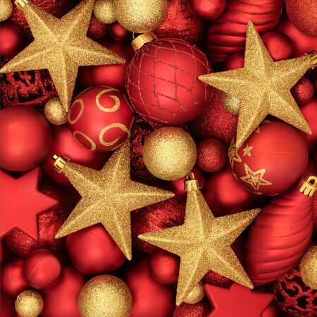 Christmas tree bauble decorations in red and gold forming a background. Traditional festive holiday theme.