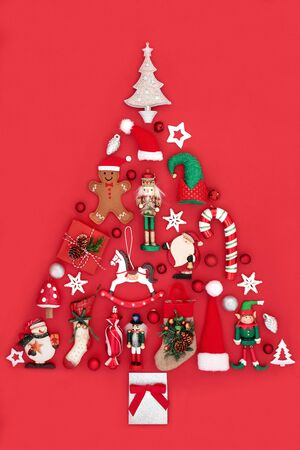Abstract Christmas tree decoration with baubles and ornaments on red background. Traditional theme with symbols for the festive season.