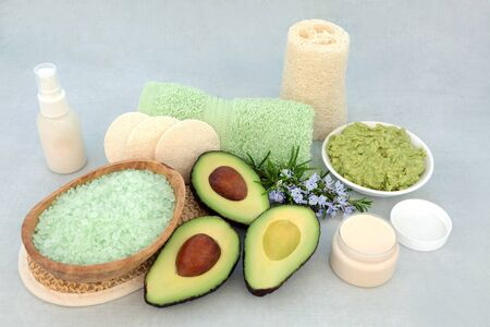 Beauty treatment for skincare with avocado face mask, rosemary herb, exfoliation mineral salts, moisturizing cream.