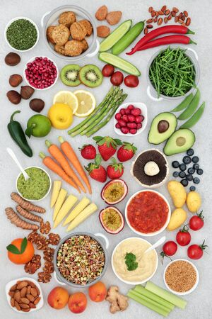 Healthy vegan super food concept with fruit, vegetables, seeds, nuts, spice, dips & falafel meat substitute. High in vitamins, minerals, antioxidants, protein, omega 3, dietary fibre & smart carbs. Flat lay.