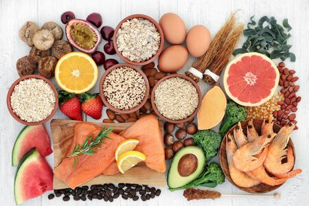 High energy health food for vitality & fitness with fish, fruit, vegetables, cereals, pasta, grain, nuts & herbs. High in vitamins, minerals, antioxidants, smart carbs, protein & omega 3. Flat lay.