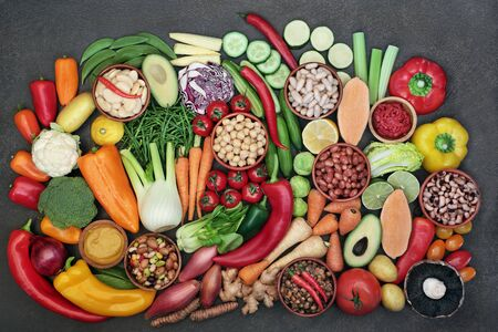 Vegan health food with super foods hgh in protein, vitamins, minerals, anthocyanins, antioxidants, fibre, omega 3 and smart carbs. Ethical eating concept. Flat lay.