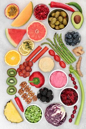 Health food for a healthy heart and cardiovascular system with fruit, vegetables, spices, dips and nuts. High in omega 3, antioxidants, protein, anthocyanins and fibre with a low GI. Flat lay.