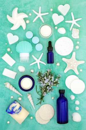 Rosemary herb vegan skin care beauty treatment with cosmetic products. With astringent & anti ageing benefits & helps to reduce environmental skin damage. Flat lay on turquoise.