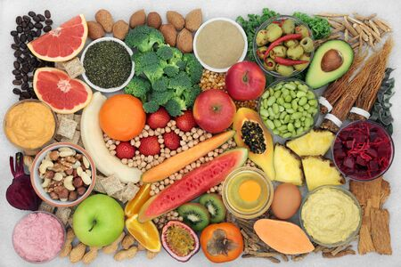 Super food food for energy, fitness and vitality with fish, fruit, vegetables, nuts & herbs used in Chinese herbal medicine.
