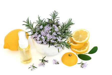 Rosemary herb & lemon skin care beauty treatment with moisturising oil on white background. Anti ageing benefits & helps to reduce environmental skin damage.