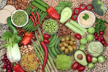 Vegan plant based food for a ethical healthy diet concept with foods high in omega 3, protein, vitamins, minerals, anthocyanins, antioxidants, smart carbs and dietary fibre. Flat lay.