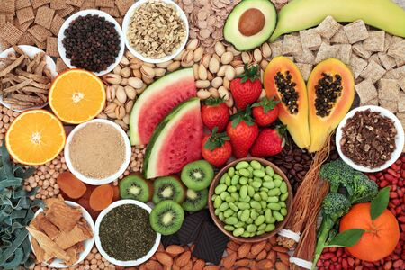 Health food for energy, vitality & fitness with fruit, vegetables, nuts, pasta, legumes, cereal & herbal medicine. High in vitamins, minerals, antioxidants, smart carbs, protein & omega 3. Flat lay.