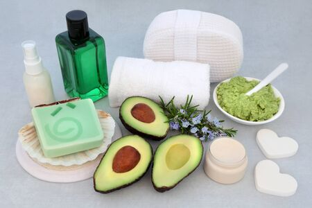Beauty treatment for skincare with avocado face mask, rosemary herb, exfoliation mineral salts, moisturising cream & lotion with cleansing products.