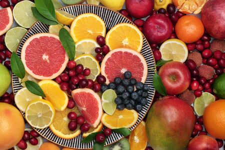 Large healthy  immune boosting fresh fruit collection on a round plate and loose. Super food very high in antioxidants, vitamins, dietary fibre and anthocaynins. Flat lay, top view. Banque d'images