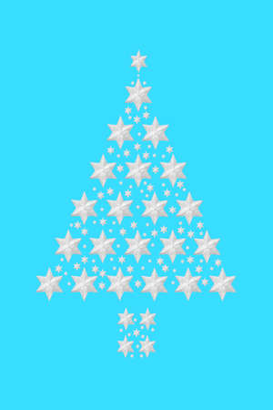 Christmas tree silver star composition on pastel blue background. Abstract festive design concept for the holiday season.