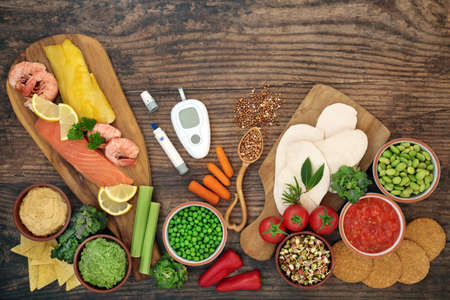 Low glycemic testing & lancing devices with health food for diabetics below 55 on the GI index. High in antioxidants, anthocyanins, vitamins, minerals, protein, omega 3 & smart carbs. Health care concept.