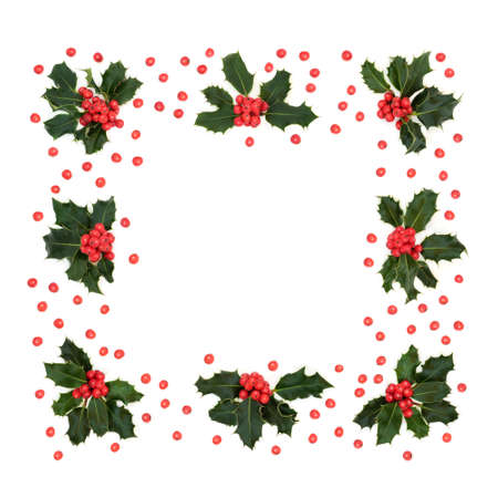 Abstract winter, Christmas & New Year square holly berry wreath with loose red berries on white background. Minimal xmas holiday composition & border for the festive season. Top view, flat lay.