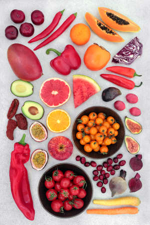 Fruit & vegetables high lycopene & anthocyanins to reduce cholesterol for a healthy heart with foods also high in antioxidants, omega 3, vitamins, minerals & dietary fibre. Flat lay on mottled grey. Zdjęcie Seryjne