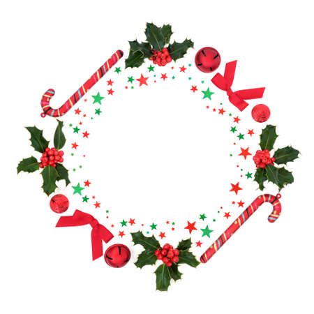 Christmas wreath with holly, bauble decorations & red & green stars on white background. Festive concept for the xmas season. Flat lay, top view, copy space. Zdjęcie Seryjne