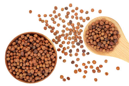 Carlin peas healthy food in a wooden spoon, bowl & loose on white background. Very high in protein, low in fat, high in fibre, antioxidants & anthocyanins with low GI. Flat lay, top view.