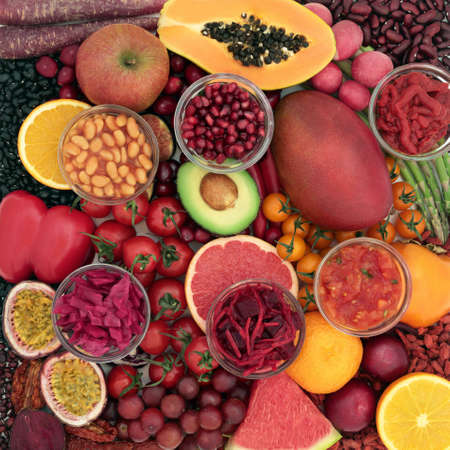 Healthy vegan,foods high in lycopene to help lower cholesterol & risk of certain cancers, foods also high in antioxidants, anthocaynins, omega 3, vitamins, minerals, & dietary fibre. Health care concept.