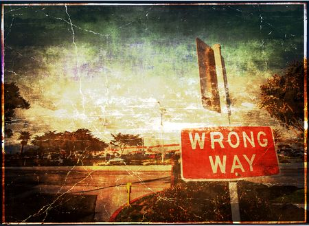 Wrong Way Vintage Grunge Sign And Background Scene Stock Photo