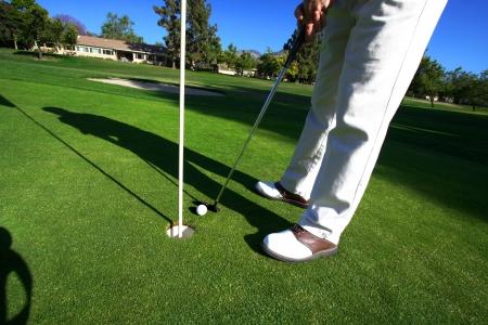 Golfer On Putting Green  photo
