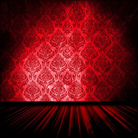 Red damask pattern wallpaper with spotlight in vintage room interior.