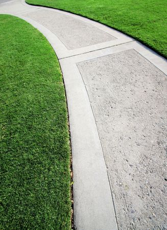 sidewalks: Long Winding Road And Green Grass Stock Photo