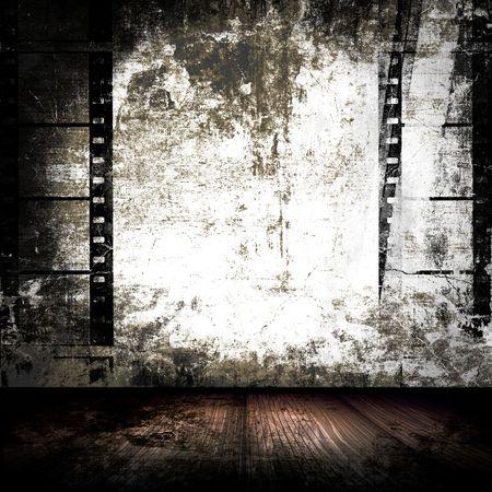 壁にフィルム ストリップと不潔な部屋