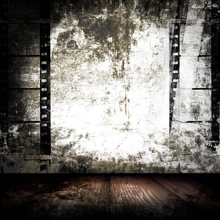 Grunge Room With Film Strips On Wall Stock Photo
