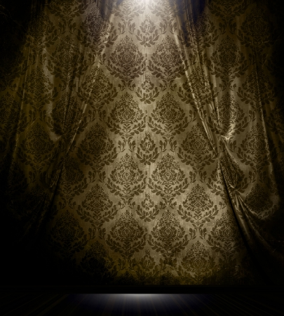 Brown damask patterned drapery with spotlight in vintage room interior.