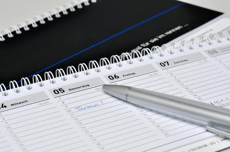 black desk diary with silver pen photo