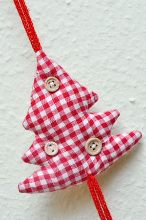weihnachtsbaum: tixtile christmas tree made of checkered textil Stock Photo
