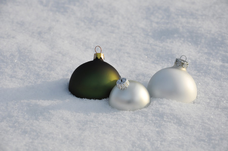 jahreswechsel: christmas baubles in the snow