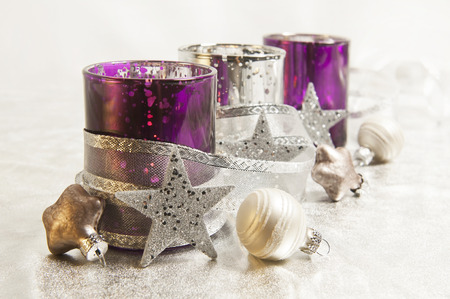 frohe: purple and silver storm lamps with Christmas balls