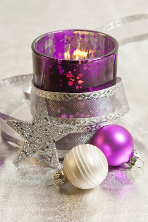 jahreswechsel: purple and silver storm lamps with Christmas balls