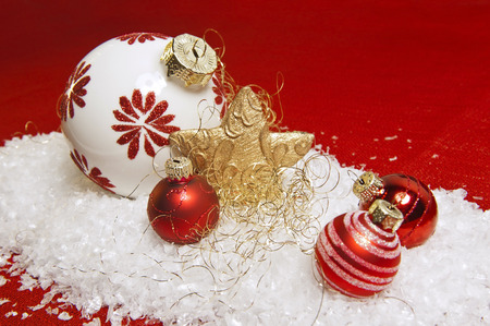 jahreswechsel: red christmas decoration on snow