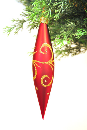 weihnachtsbaum: hang up red christmas decoration Stock Photo