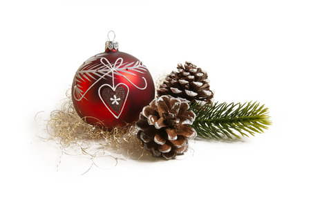 red christmas ball with fir cones