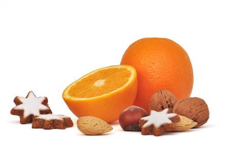 orange, cinnamon stars and nuts photo