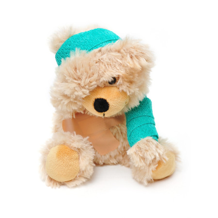 sch: brown teddy bear with bandage and plaster Stock Photo