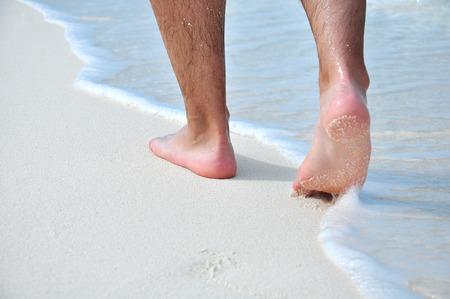 mensch: man takes a beach walk